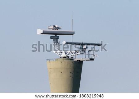 COASTAL SURVEILLANCE radar system. Two marine radars on tower. Royalty-Free Stock Photo #1808215948