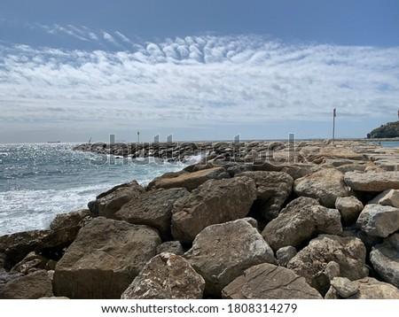 Cloud effect above breakwater in Mediterranean, Gibraltar Royalty-Free Stock Photo #1808314279