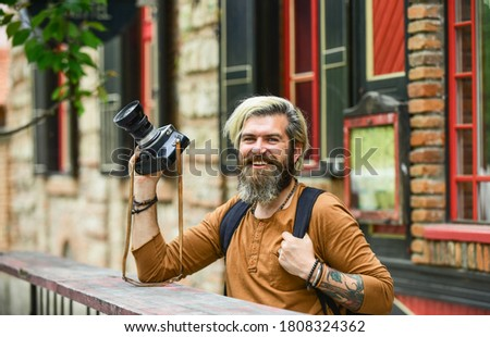 Total relaxation. vintage camera. capture these memories. SLR camera. hipster man with beard use professional camera. photographer hold retro camera. journalist is my career. reporter make photo.