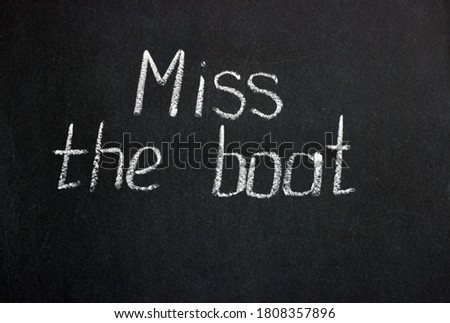 Chalkboard lettering Miss the boat. Common phrase in English