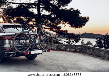 Crossover car with two road bicycles loaded on a rack Royalty-Free Stock Photo #1808368375