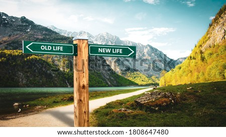 Street Sign the Direction Way to NEW LIFE versus OLD LIFE Royalty-Free Stock Photo #1808647480