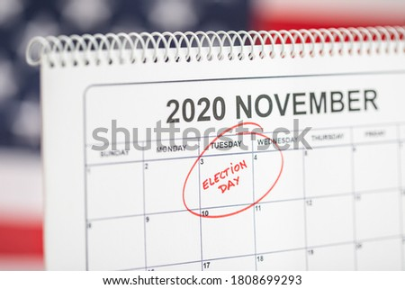 November 3, 2020 Election day concept. Desk calendar with November 3rd marked in red and USA flag at background #1808699293
