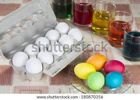 Coloring eggs in bright colors for Easter holiday #180870356