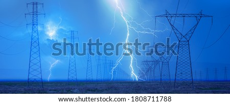 High voltage power line with amazing  lightning