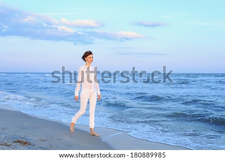 Young woman in  walking on beach #180889985