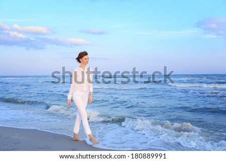 Young woman in  walking on beach #180889991