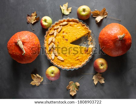 Thanksgiving Day celebration. Thanksgiving pumpkin. Traditional pie. The pie lies on a black background. Thanksgiving Day. space for text