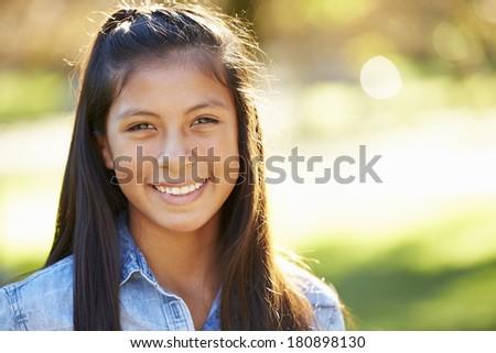 Portrait Of Hispanic Girl In Countryside