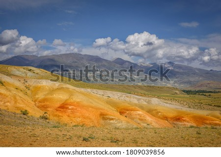 Amazing natural phenomenon-Martian landscapes in the Altai mountains. Multicolored rocks against a blue sky with white clouds. Futuristic panoramic picture, background image. Mars.