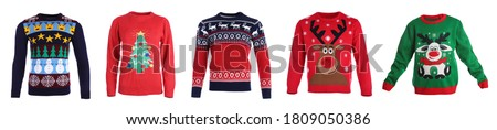 Set of warm Christmas sweaters on white background. Banner design #1809050386