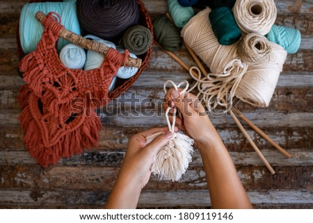 Weaving macrame at home. Hand of a woman when she is making macrame.  Royalty-Free Stock Photo #1809119146