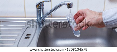 Drinking water in the test tube for chemical and microbiological analysis Royalty-Free Stock Photo #1809134578