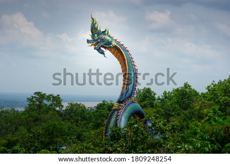 Naga stucco work Mythical creatures associated with Southeast Buddhism. Royalty-Free Stock Photo #1809248254