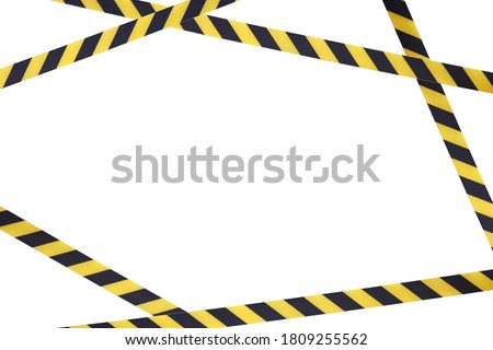 Black and yellow lines of barrier tape prohibit passage. Barrier tape on white isolate. Barrier that prohibits traffic. Warning tape. Danger unsafe area warning do not enter. Concept of no entry #1809255562