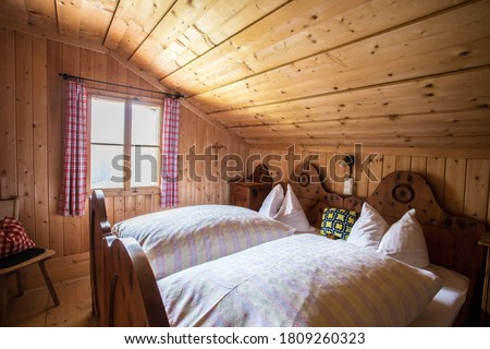 Inside of a rustic wooden alpine hut or cabin, Austria Royalty-Free Stock Photo #1809260323