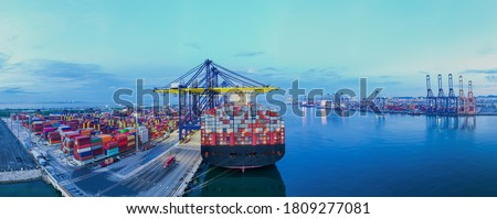 Rear view cargo container ship. Business logistic transportation sea freight, Cargo ship, Cargo container in deep sea port at industrial estate for import export around in the world Royalty-Free Stock Photo #1809277081