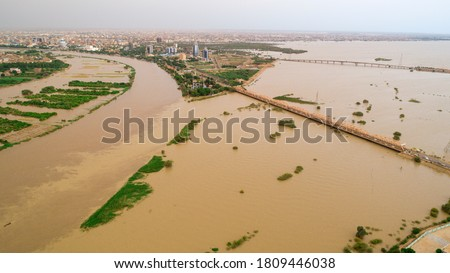 An image showing the size of the Nile River flood that hit the capital, Khartoum #1809446038