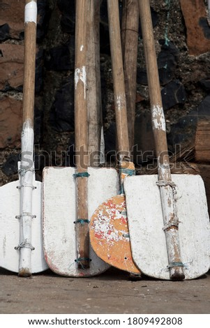 Koliwada, Maharashtra / India - October 05, 2006 : A still life view of the oars placed in the village. Royalty-Free Stock Photo #1809492808