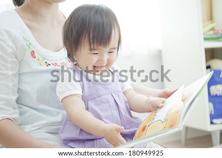 Japanese girl reading a picture book to her mother,