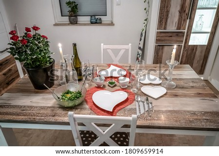 Valentines day dinner setting romantic love for two wooden table red heart shape candle light with roses Royalty-Free Stock Photo #1809659914