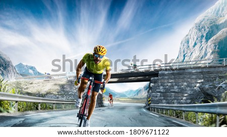 Professional road bicycle racer in action Royalty-Free Stock Photo #1809671122