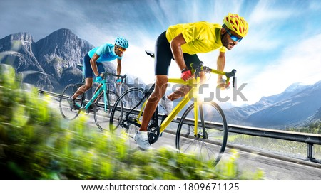 Professional road bicycle racer in action Royalty-Free Stock Photo #1809671125