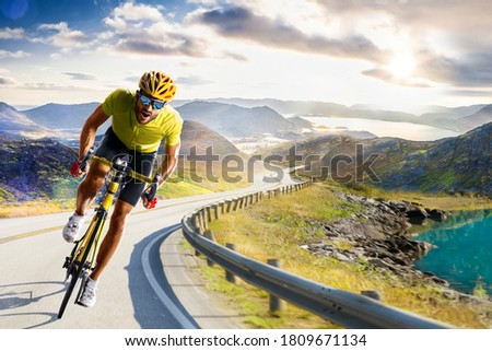 Professional road bicycle racer in action Royalty-Free Stock Photo #1809671134