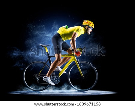 Professional road bicycle racer in action isoated on the black background Royalty-Free Stock Photo #1809671158