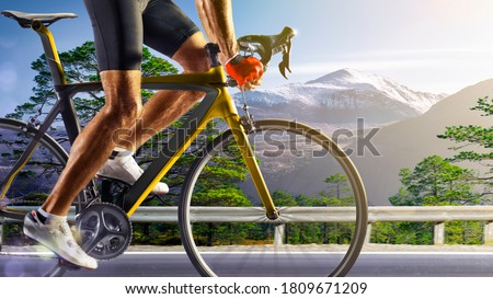 Professional road bicycle racer in action Royalty-Free Stock Photo #1809671209