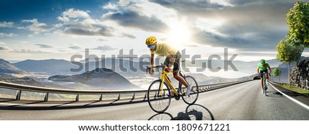 Professional road bicycle racer in action Royalty-Free Stock Photo #1809671221