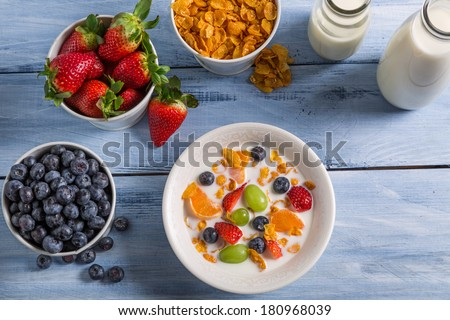 Preparations for breakfast corn flakes and fruits #180968039