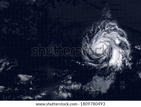 Storm over sea for background, view of tropical hurricane eye from space. Ocean typhoon on satellite photo of Earth. Concept of weather, disaster and warning. Elements of this image furnished by NASA Royalty-Free Stock Photo #1809780493