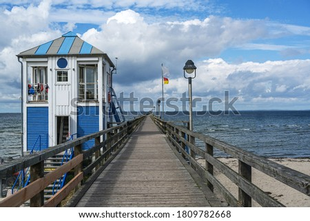 Lifeguard station house at the sea-bridge of Lubmin under a blue sky with clouds, seaside tourist resort for beach holidays at the Baltic Sea in Mecklenburg-Western Pomerania, Germany, copy space Royalty-Free Stock Photo #1809782668