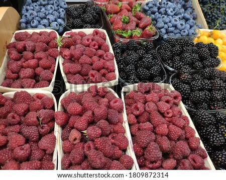 sale of berries in the store: raspberries, blueberries, blackberries, strawberries. black, red, blue berries for sale