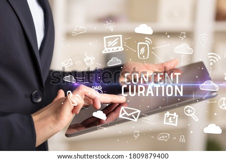 Close-up Of A Person Using Social Networking with CONTENT CURATION inscription