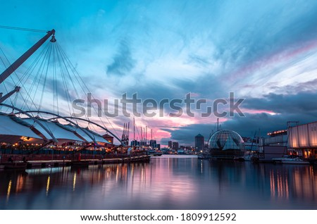 Stunning sunset in the ancient harbour of Genoa Royalty-Free Stock Photo #1809912592