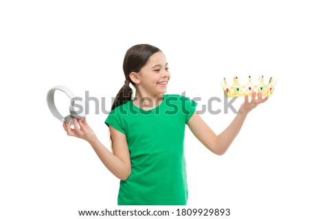 royalty free music. pop princess. queen of music. portrait of cheerful girl isolated on white. happy childhood. small girl choose between crown and headphones. being a super star. best hit list.