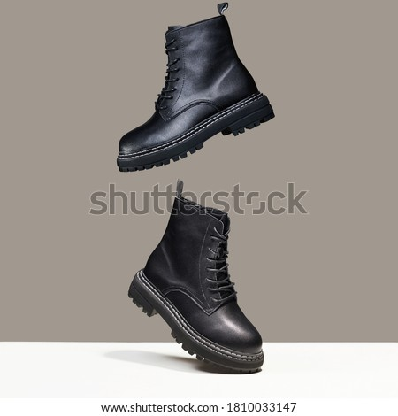 Black boots in the air. fashion shoes still life. stylish photo in the studio Royalty-Free Stock Photo #1810033147