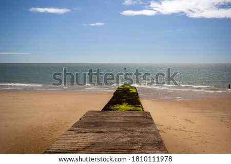 Groynes on the beach at high tide. Walton on the Naze, Essex, United Kingdom Royalty-Free Stock Photo #1810111978