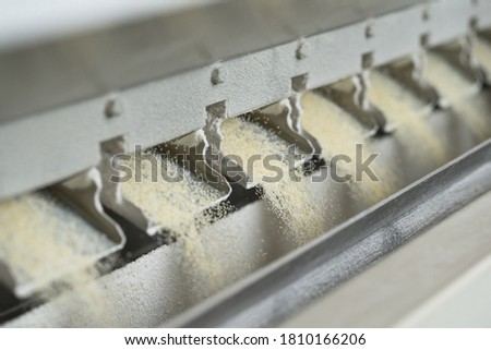 Modern mill inside, process of making flour from wheat Royalty-Free Stock Photo #1810166206