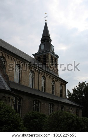 Shot on a cloudy day, which sets the mood for the whole picture. We have pictures of a church located near Mol, Belgium.  Monks make cheese, beer, etc.. in nearby shops to support themselves.