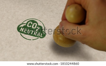 CO2 carbon neutral emission stamp and stamping hand. Ecology, nature friendly, climate change, green fuel and earth protect concept. Royalty-Free Stock Photo #1810244860