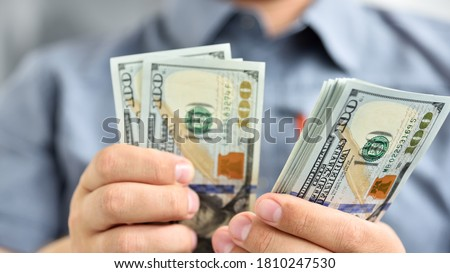 Businessman counting hundred dollar bills. Money and trade concept. Close up #1810247530