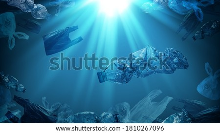 creative background of PET plastic bottles and single-use plastic bags floating in sea or ocean with rays of sunlight effect, polyethylene terephthalate plastic, concept of environmental pollution. Royalty-Free Stock Photo #1810267096