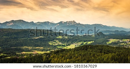 Panorama of Alpine mountains near Lake Worthersee and Velden city. Travel destination in Austria Royalty-Free Stock Photo #1810367029