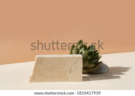 Minimal modern product display on beige background with podium Royalty-Free Stock Photo #1810417939