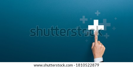 Businessman pushing button positive thing. Business for Profit, Benefit, health insurance, Development and growth concepts. Represented by a plus sign with copy space