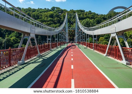 Park pedestrian bridge over the Dnieper River, which connects the central part of Kiev with the park area and the beaches of Trukhanovy Island. #1810538884