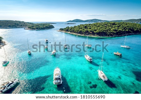 Aerial view of Paklinski Islands in Hvar, Croatia. Turquise water bays with luxury yachts and sailing boats. Toned image. Royalty-Free Stock Photo #1810555690